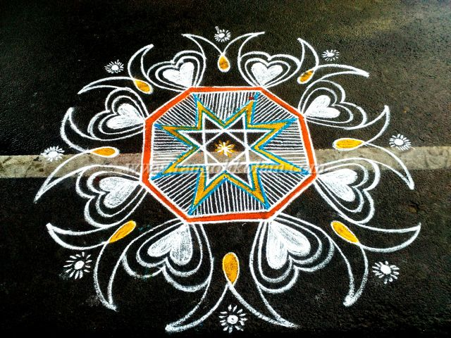 white with colour kolam